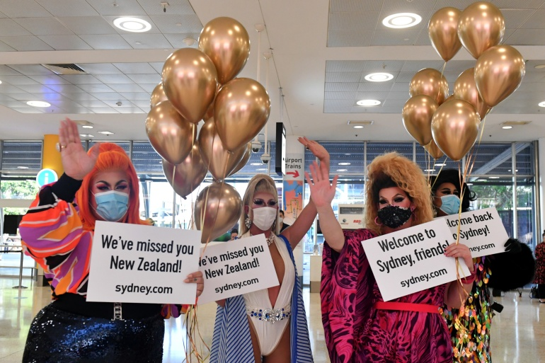 Drag queens welcome New Zealand travellers at Sydney airport as quarantine-free travel between Australia and New Zealand begins [Mick Tsikas/AAP Image via Reuters]