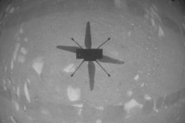 The shadow of NASA's Mars helicopter Ingenuity is seen during its first flight on the planet in this still image taken from a video [NASA/JPL-Caltech/ASU/Handout via Reuters]