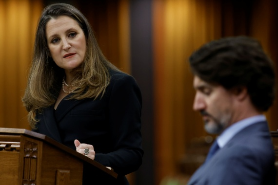 Canada's Finance Minister Chrystia Freeland watches Prime Minister Justin Trudeau as she delivers the budget in the House of Commons in Ottawa [Blair Gable/Reuters]