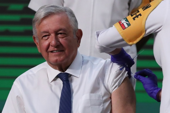 Mexico's President Andres Manuel Lopez Obrador receiving the first dose of the AstraZeneca vaccine on April 20, 2021 [Henry Romero/Reuters]