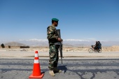 An Afghan National Army soldier stands guard at a checkpoint on the outskirts of Kabul [File: Mohammad Ismail/Reuters]