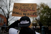 Activists say since the year 2000 some 465 cases that involved an officer-involved killing should be be reopened. [Brian Snyder/Reuters]