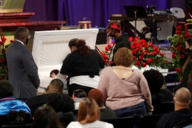 Katie Wright, the mother of Daunte Wright, touches her son in a coffin during a viewing service, after he was shot and killed by Brooklyn Center Police Officer Kim Potter, at his public viewing at Shiloh Temple International Ministries in Minneapolis, Minnesota, US [Octavio Jones/Reuters]