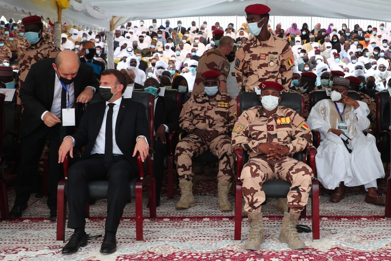 French President Emmanuel Macron (L) sits in the front row next to Mahamat Idriss Deby, son of the late Chadian president and new interim leader during the state funeral [Christophe Petit Tesson/Pool via Reuters]