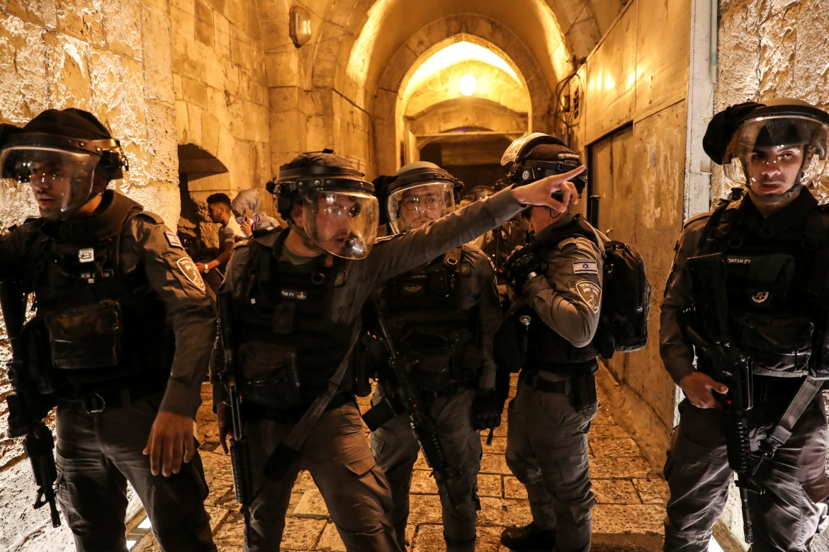 Israeli police officers patrol during tension with Palestinians inside Jerusalem's Old City. [Ronen Zvulun/Reuters]