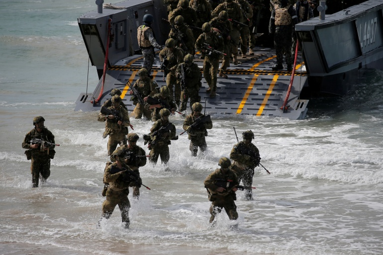 Soldiers from the Australian Army's 3rd Brigade participate in an amphibious assault landing exercises between Australia and the United States in 2017 [File: Jason Reed/Reuters]