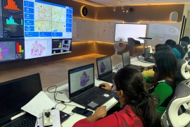 Software professionals assisting municipal authorities work on their terminals inside a COVID-19 'war room' in Bengaluru [File: Reuters]