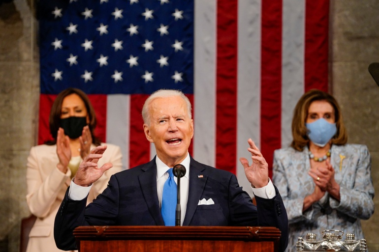 President Joe Biden addresses a joint session of Congress, with Vice President Kamala Harris and House Speaker Nancy Pelosi on the dais behind him, in Washington on April 28, 2021 [Melina Mara/Pool via Reuters]