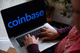 Coinbase opened for trading on the Nasdaq at $381 a share and quickly climbed to $429, but lost steam to close at $328 [File: Tiffany Hagler-Geard/Bloomberg]