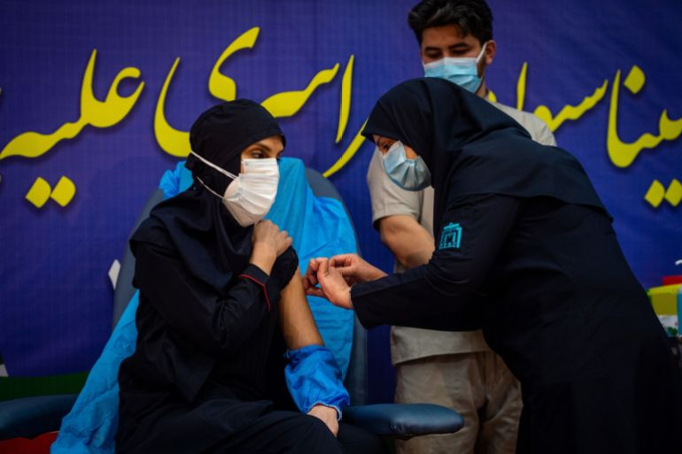 A medical worker administers a dose of Russia's Sputnik V vaccine at the Imam Khomeini hospital in Tehran [Ali Mohammadi/Bloomberg]