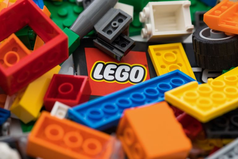 Lego makes almost 100,000 tonnes of plastic bricks a year and is trying to make a product using plant-based material [File: Chris Ratcliffe/Bloomberg]