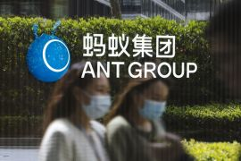 Ant's valuation may drop by about 60 percent from the $280bn it was pegged at last year as a result of the proposed rule changes, analysts say [File: Qilai Shen/Bloomberg]