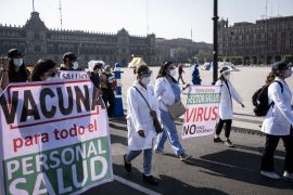 Private-sector health workers march during a demonstration in Mexico City, Mexico, where medical associations and colleges have demanded that President Andres Manuel Lopez Obrador prioritise all medical staff in the country for COVID-19 vaccines [File: Bloomberg]