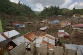 Devastating storms and flooding decimated the Guatemalan village of Campur, but some residents have since returned to try to rebuild [Jeff Abbott/Al Jazeera]