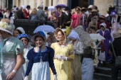 Participants in the annual Jane Austen Regency Costumed Parade walk through the centre of Bath in England on September 9, 2017 [File: Matt Cardy/Getty Images]