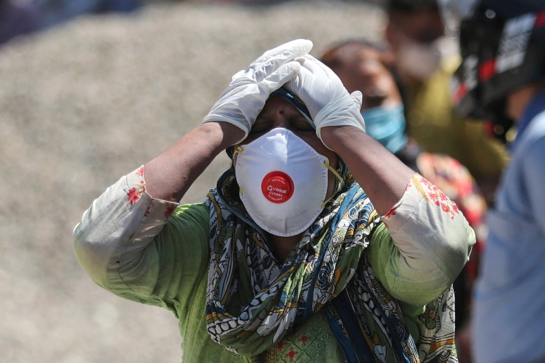 India COVID death toll tops 200,000 as essential supplies run out