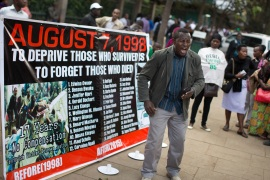 Kenyan relatives of victims and those injured from the 1998 bombing of the US Embassy in Nairobi protest outside the Memorial Park at the site of the bombing, in Nairobi, Kenya in 2015 [File: Ben Curtis/The Associated Press]