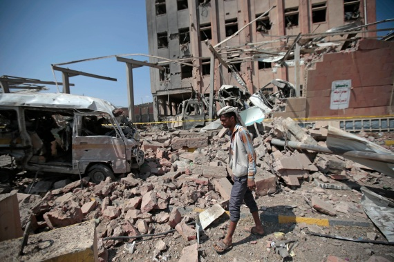 A man inspects rubble after a Saudi Arabia-led coalition air attack in Sanaa, Yemen, in 2018 [File: Hani Mohammed/AP Photo]