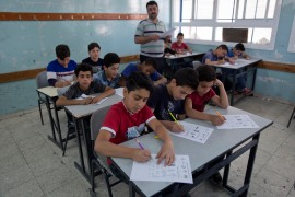 A teacher supervises Palestinian students during a final exam at a school run by UNRWA in the West Bank city of Hebron on May 26, 2019 [File: AP Photo/Nasser Nasser]
