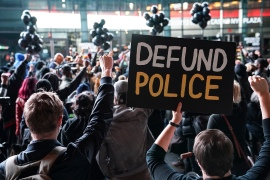 "While calls to ""defund"" police departments persist, Democratic leaders are distancing themselves from those demands [File: John Minchillo/AP Photo]"