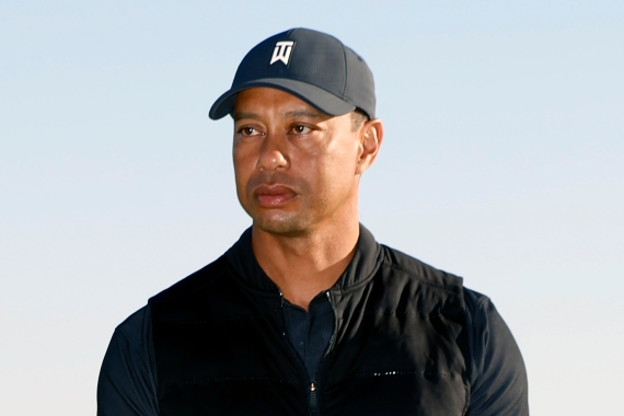 Tiger Woods looks on during the trophy ceremony after the final round of the Genesis Invitational golf tournament on February 21, 2021 in Pacific Palisades, California, the United States [File: Ryan Kang/AP Photo]