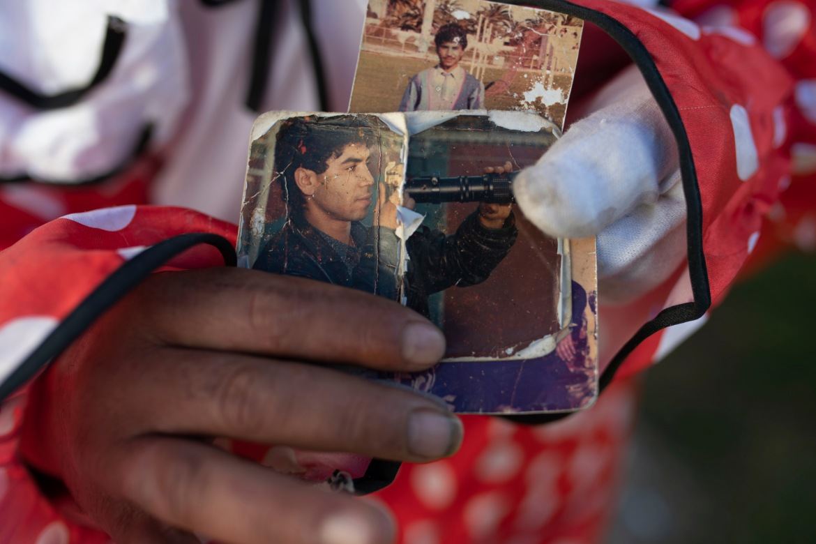 Abdelsalam displays images of his younger self as a sports photographer in the 1980s. [Mosa'ab Elshamy/AP Photo]