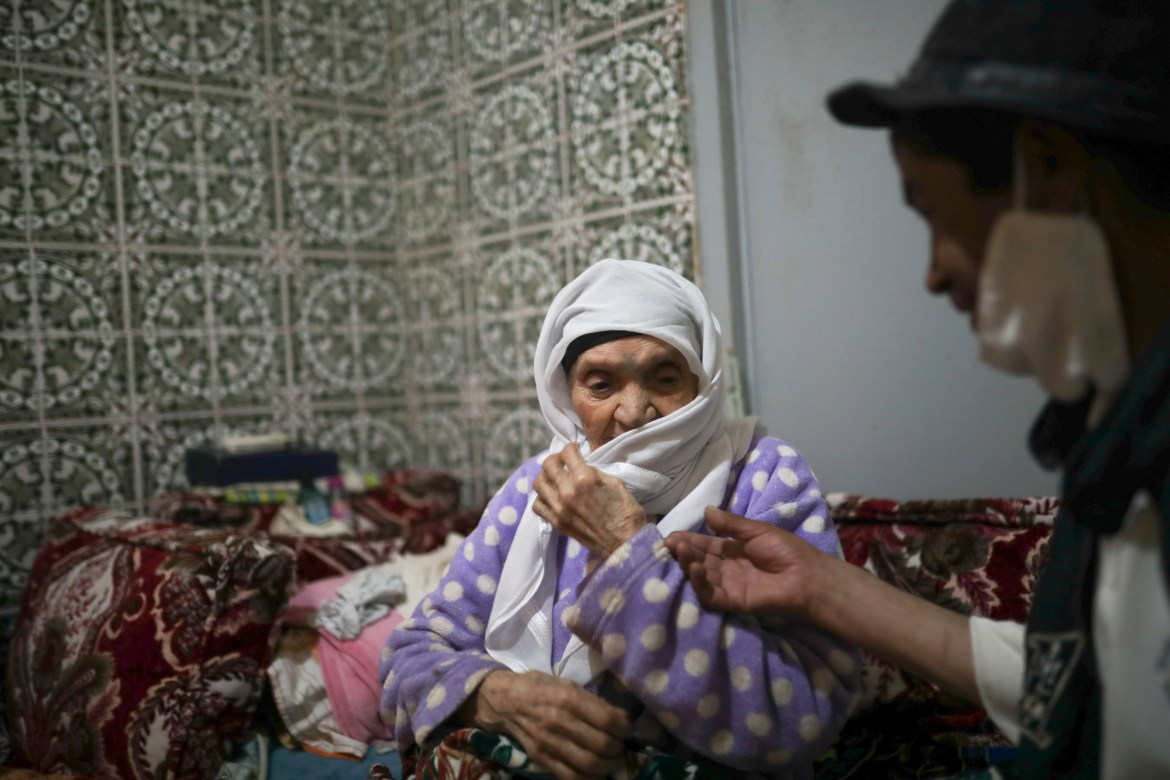 He survives by being young at heart and spending time with his beloved 90-year-old mother Nadia. [Mosa'ab Elshamy/AP Photo]