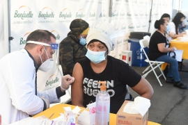 The US has ramped up its vaccine campaign, with an average of more than three million doses administered each day over the past seven days [Jordan Strauss/Ready Pac Foods, Inc via A]