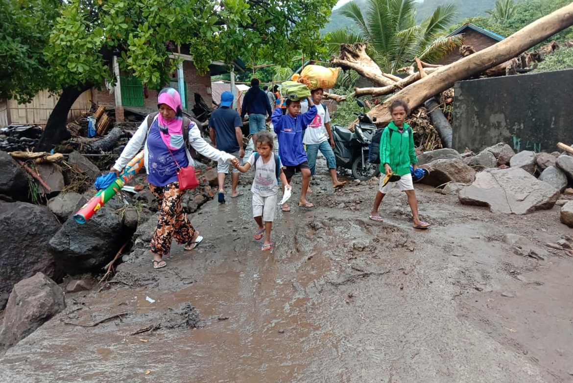 Multiple disasters caused by torrential rains in eastern Indonesia have left dozens of people dead or missing while displacing thousands. [Ricko Wawo/AP Photo]