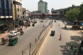 A few vehicles ply on a usually clogged street during a coronavirus lockdown in Dhaka last week [Al-emrun Garjon/AP]