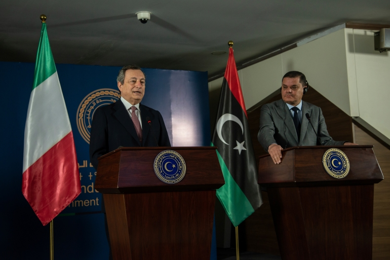 During his first overseas trip since taking office in February, Mario Draghi held talks with Libya's interim Prime Minister Abdul Hamid Dbeibeh in the Libyan capital, Tripoli, on Tuesday [Nada Harib/AP Photo]