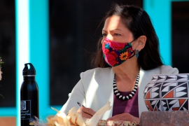 Interior Secretary Deb Haaland listens to tribal leaders and jots down notes during a round-table discussion at the Indian Pueblo Cultural Center in Albuquerque, New Mexico on April 6 [File: Susan Montoya Bryan/AP Photo]