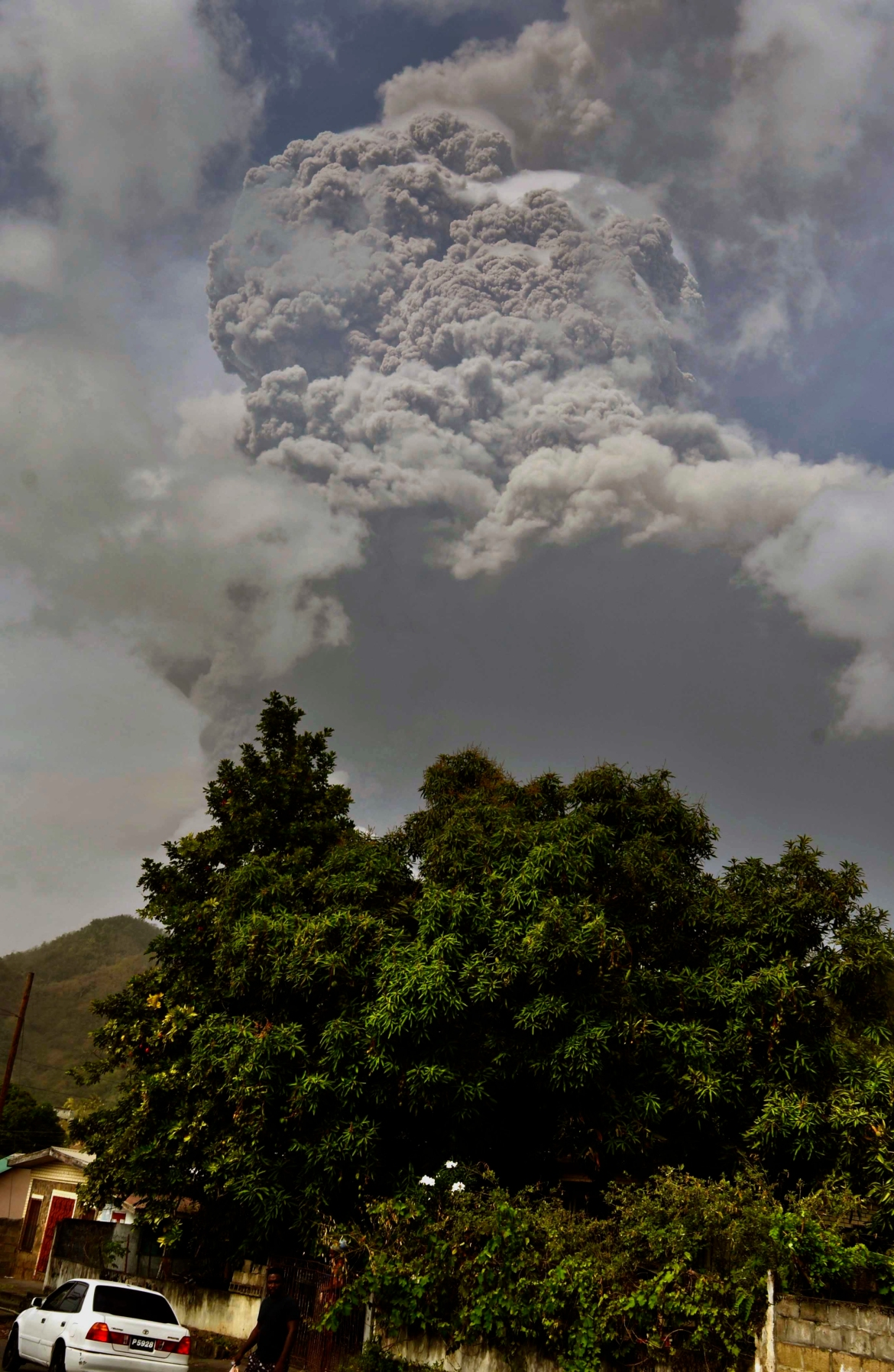 Plumes of ash rise from the volcano which erupted for the first time in 40 years on the Caribbean island of Saint Vincent on Friday, prompting thousands of people to evacuate. [Orvil Samuel/AP Photo]