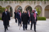 Jordan's King Abdullah II, second right, Prince Hamzah bin Al Hussein, fourth right in blue mask, Prince Hassan bin Talal, fifth right, and others arriving to visit the tombs of former kings in Amman [File: Royal Court Twitter Account via AP]