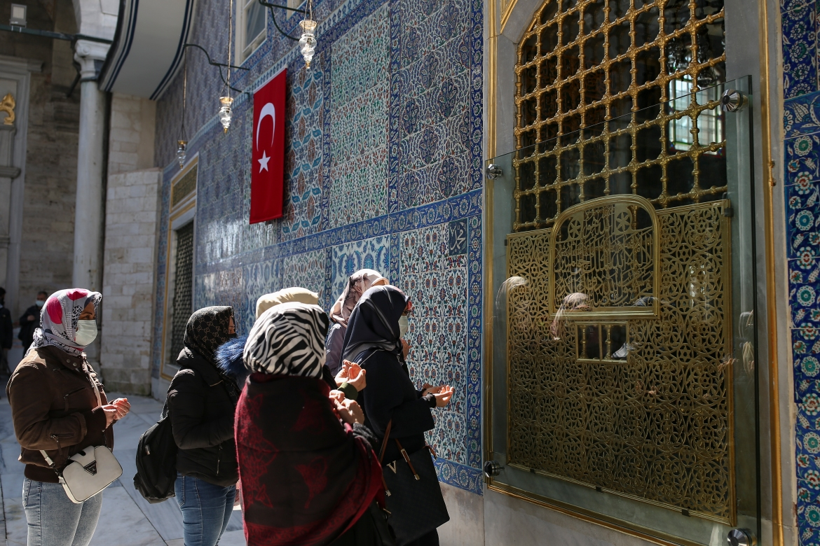 Women offer their prayers at the Eyup Sultan Mosque, in Istanbul, a day before Ramadan. Turkey's President Recep Tayyip Erdogan was forced to announce renewed restrictions following a spike of COVID-19 cases, such as weekend lockdowns and the closure of cafes and restaurants during Ramadan, starting on April 13. [Emrah Gurel/AP Photo]