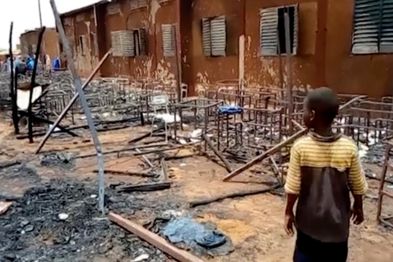 This video screengrab shows burned chairs, tables and other objects in the school [Boureima Issoufou/AP Photo]