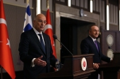 Greek Foreign Minister Nikos Dendias gestures as he talks during a joint media statement with Turkish Foreign Minister Mevlut Cavusoglu, right [Burhan Ozbilici/AP Photo]