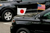 The car carrying Japanese Prime Minister Yoshihide Suga arrives at the White House campus, Friday April 16, 2021 [Andrew Harnik/AP Photo]