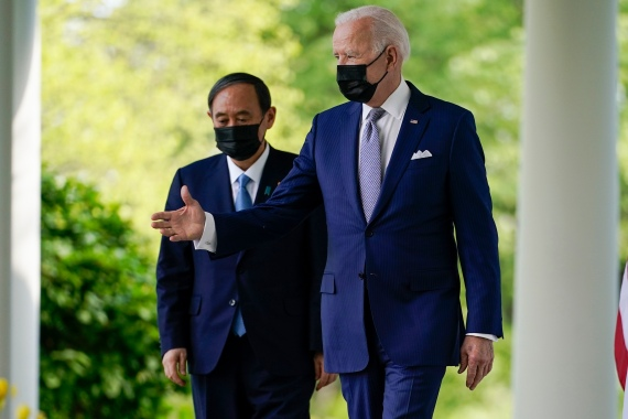President Joe Biden, accompanied by Japanese Prime Minister Yoshihide Suga, walks from the Oval Office to speak at a news conference in the Rose Garden of the White House [Andrew Harnik/AP Photo]