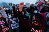 Demonstrators chant as they march towards the Brooklyn Center Police Department during a protest against the fatal shooting of Daunte Wright during a traffic stop, Friday, April 16, 2021, in Brooklyn Center, Minnesota [John Minchillo/ AP]