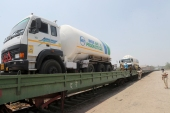 Empty tankers near Mumbai being transported to collect liquid medical oxygen from other states [Rafiq Maqbool/AP]