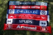 Scarves of the English Premier League clubs who are part of a proposed European Super League [Alastair Grant/AP Photo]