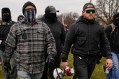 Proud Boys members Joseph Biggs, left, and Ethan Nordean, right with megaphone, walk towards the US Capitol in Washington on January 6 [File: Carolyn Kaster/ AP Photo]