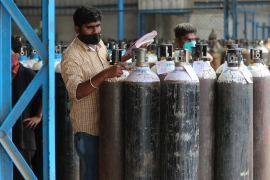 A shortage of oxygen cylinders in certain areas has Indian COVID-19 patients gasping for air [Aijaz Rahi/AP Photo]