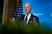 United States President Joe Biden campaigned on making the capital gains and income tax rates for wealthy individuals more equitable, saying it's unfair that many of them pay lower rates than middle-class workers [Evan Vucci/AP]