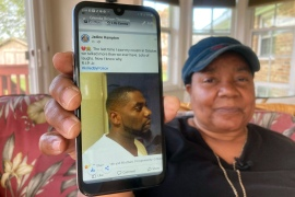 Glenda Brown Thomas displays a photo of her nephew, Andrew Brown Jr, on her cell phone at her home in Elizabeth City, North Carolina [Allen G. Breed/AP Photo]