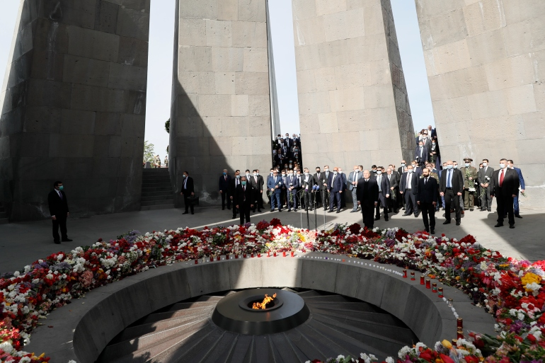 Armenian Prime Minister Nikol Pashinyan, centre, attends a memorial service at the monument to the victims of mass killing of Armenians in the Ottoman Empire during World War I [Tigran Mehrabyan/PAN Photo via AP]