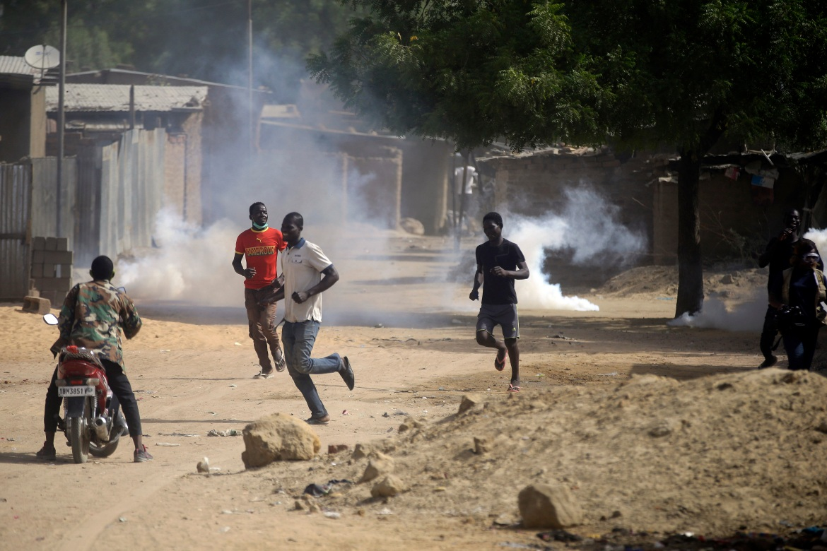 Police fire tear gas in the capital to disperse small groups of demonstrators. [Sunday Alamba/AP Photo]