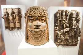 Three pieces of the Benin bronzes displayed at the Museum of Art and Crafts in Hamburg, Germany [File: Daniel Bockwoldt/dpa via AP])