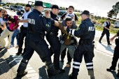 In this image from September 9, 2015, police grab a refugee as hundreds walk on a motorway near Padborg in Denmark [File: Martin Lehmann/AP Photo/POLFOTO]